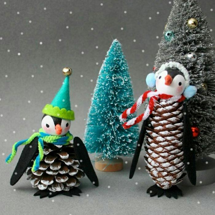 weihnachtendeko fenster basteln süße pinguine zwei aus zapfen und filz diy