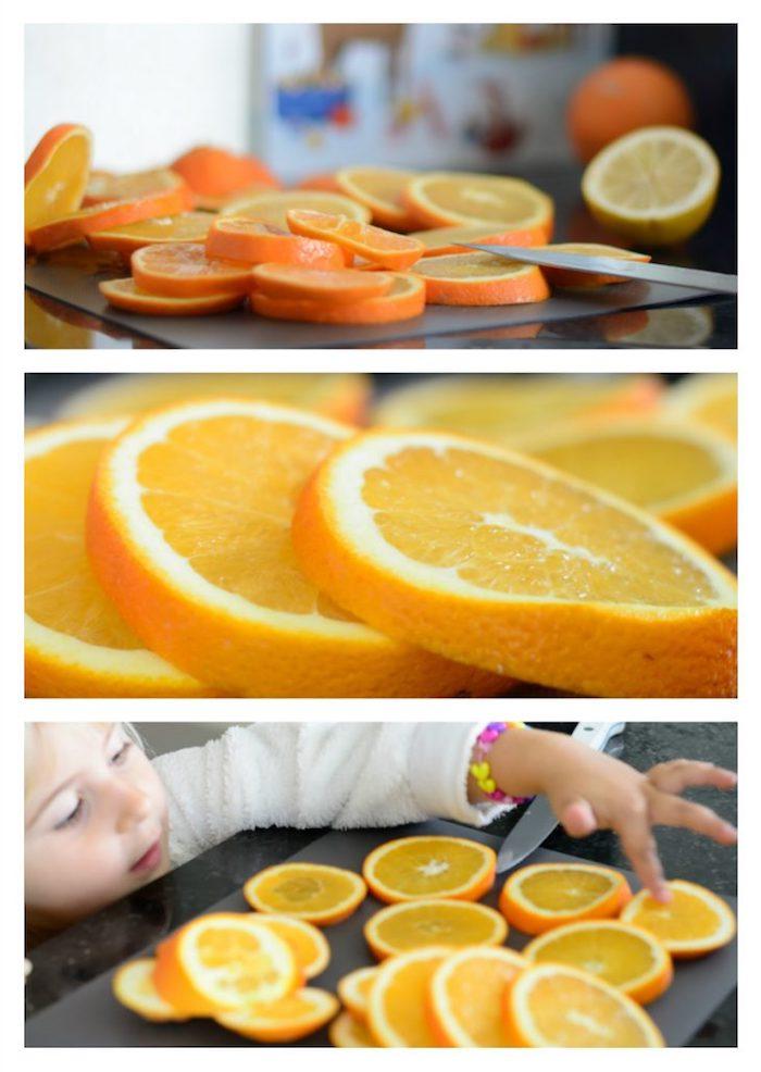 Orangen in Scheiben schneiden und trocknen lassen, Weihnachtsschmuck mit Kindern basteln