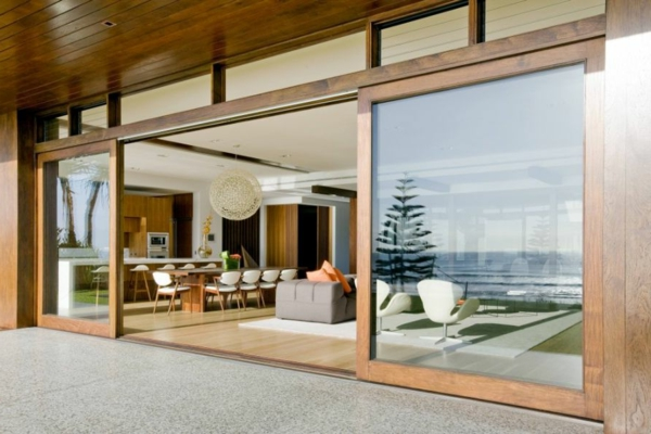 Large-sliding-glass-doors-with-wooden-frame
