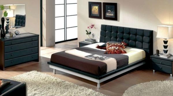 zimmer inspiration - schwarzes kopfbrett und weiße teppiche