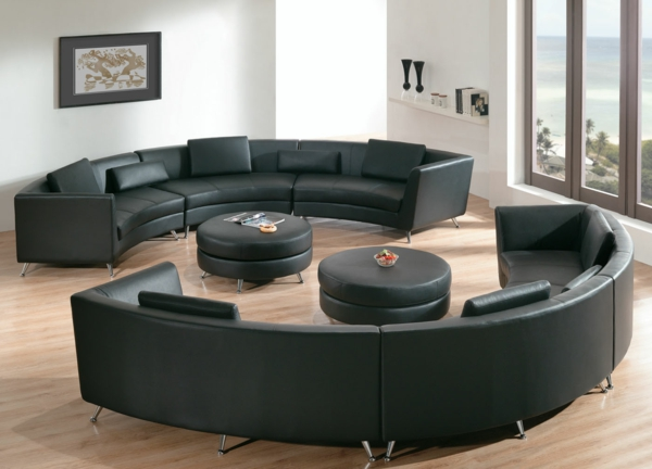 living-room-furniture-black-leather-round-sectional-sofa-in-small-apartment-living-room-with-black-round-leather-coffee-table-also-shaw-laminate-wood-flooring-astonishing-round-sectional-sofa-design