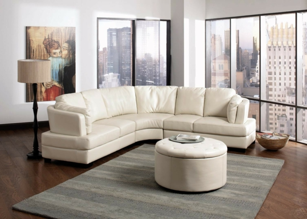 living-room-furniture-cool-apartment-living-room-with-white-leather-round-sectional-sofa-and-handpainting-canvas-wall-art-also-black-window-frames-astonishing-round-sectional-sofa-design
