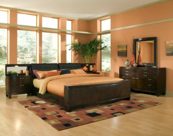 pflanzen-im-schlafzimmer-mit-einem-spiegel-neben-dem-bett