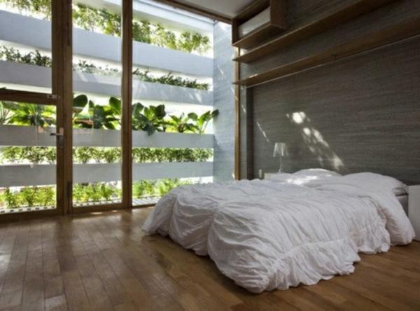 pflanzen-im-schlafzimmer-mit-einer-einmaligen-wandgestaltung