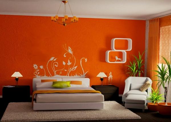 pflanzen-im-schlafzimmer-mit-oranger-wandgestaltung