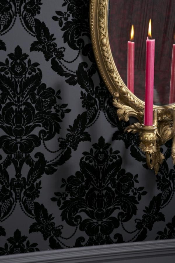 samt-tapete-und-samt-möbel-elegante-schwarze-tapete-und-ein-ovalförmiger-spiegel-an-der-wand