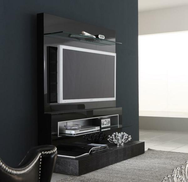 stilvoller-schwarzer-tisch-schwarze-wand-wohnzimmergestaltung