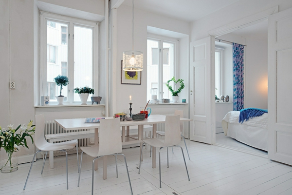 ultramodern-dining-room-white-wall-doors-chandelier-chairs