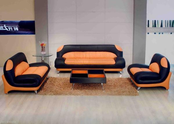 wohnzimmer-design-sofa-leder-mit-elegantem-design-orange-schwarz
