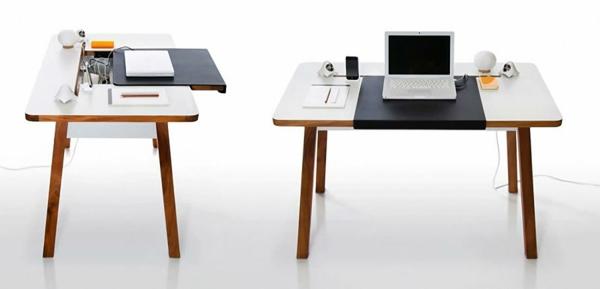 moderner weißer designerschreibtisch - mit einem laptop darauf