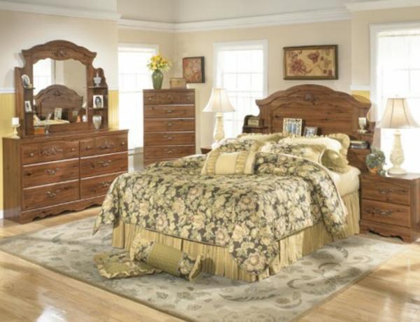 schlafzimmer imlandhausstil - spiegel und hölzerner schrank daneben
