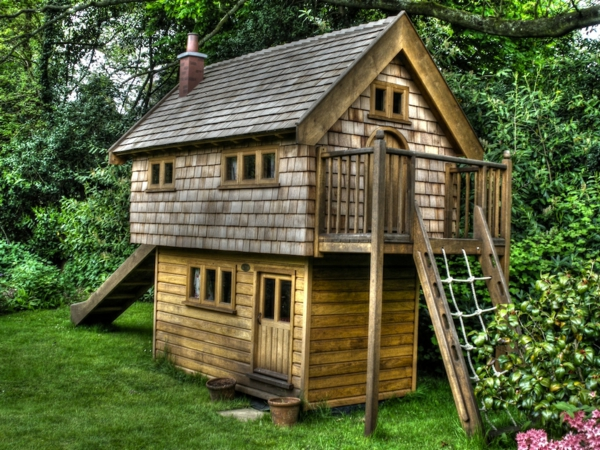 In-the-garden-Walnut-cottage-two-storey-custom-built-wooden-play-house-playhouse-with-shingle-roof