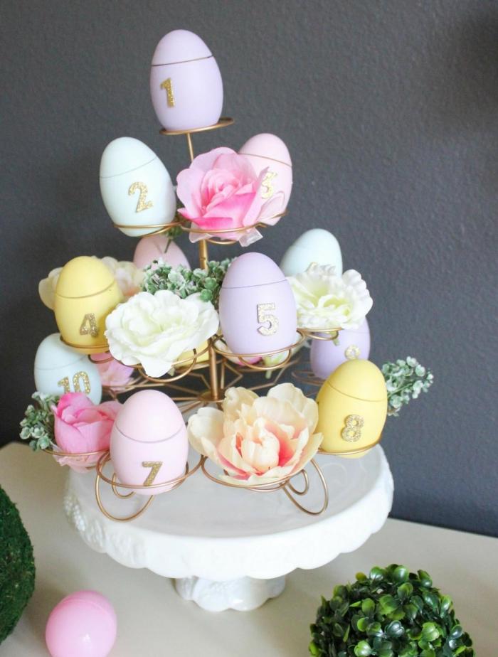 schöne tischdeko zum ostern selber machen, goldenes eiergestell, osterparty ideen