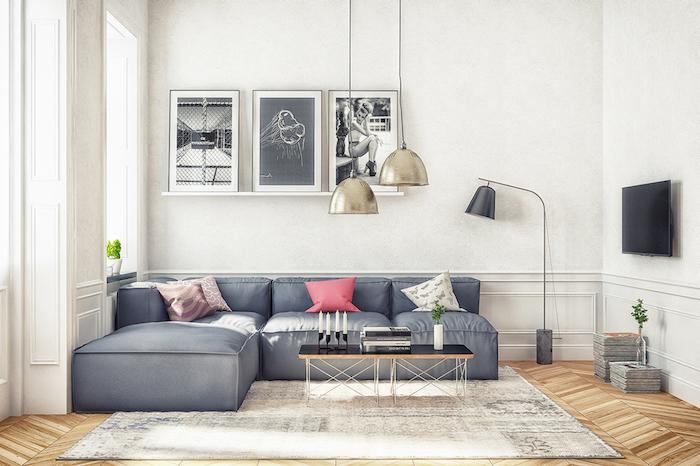 Wohnzimmer in Skandinavischer Stil einrichten, Wandfarbe Weiß, graues Sofa, drei Bilder an Wand, viereckiger simpler Couchtisch