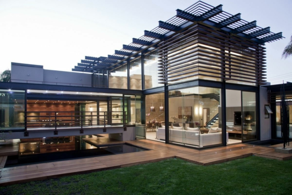 exterior-delightful-modern-house-architecture-design-with-glass-wall-with-glass-sliding-door-and-white-sofa-together-with-brown-deck-with-green-yard-deluxe-modern-house-architecture-designs
