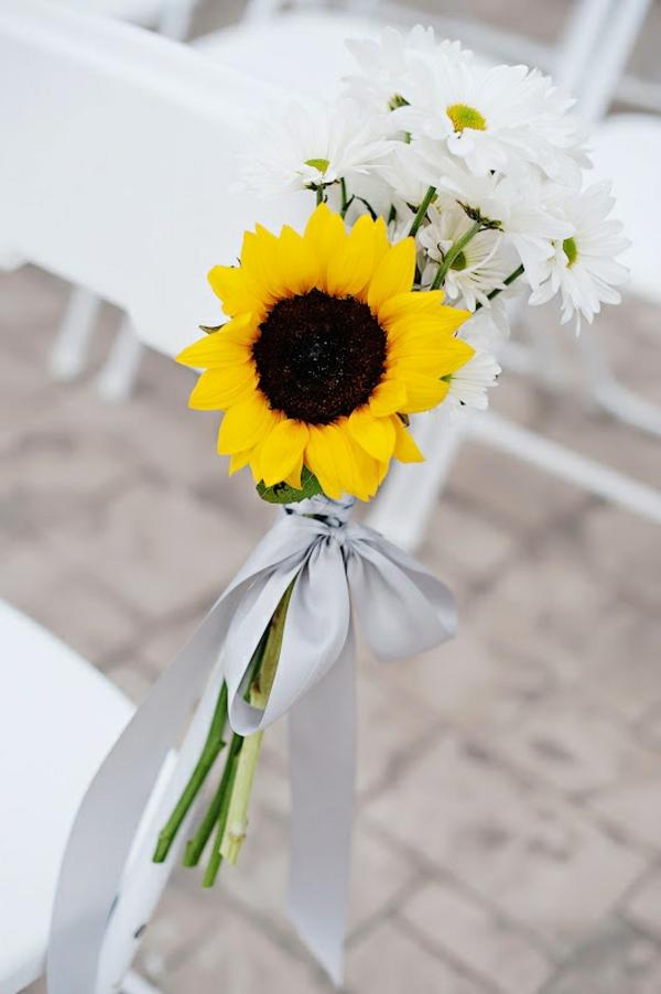 hochzeitsdeko-mit-weißen-blumen-deko-ideen-hochzeitsdekoration-mit-gänseblümchen-und-sonnenblumen