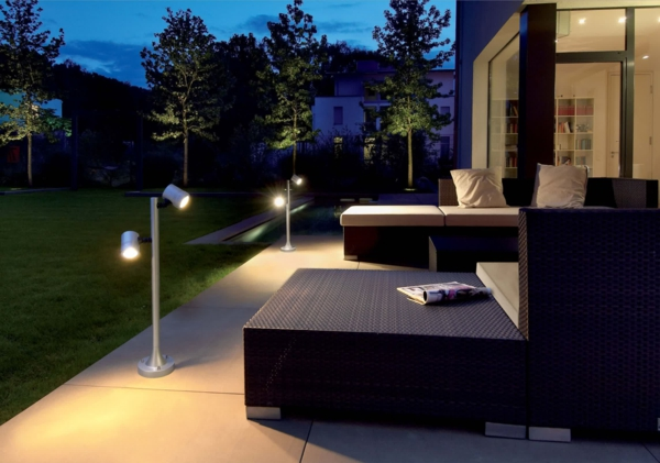outdoor-space-lighting-ideas-with-garden-floor-lamp-rattan-seat-and-wooden-table-white-mattress-and-cushion-wide-glass-window