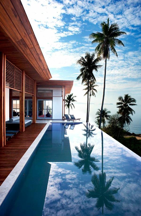 schwimmbecken-mit-palmen-design-idee-infinity-pool-wunderschönes-design