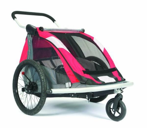 kinder-fahrradanhänger-tolles-modell-in-rosiger-farbe-weißer-hintergrund