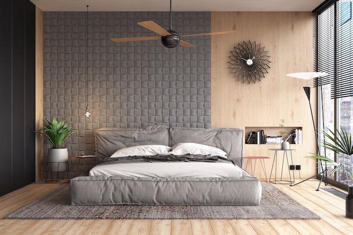Schlafzimmer Ideen in Grau, Bücherregal integriert in der Wand, Wanduhr in Form von Blume