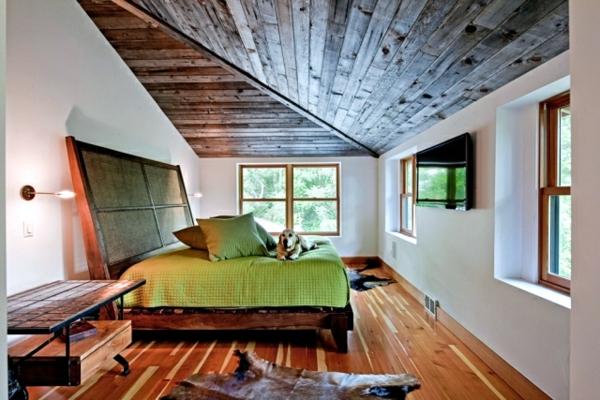 schlafzimmer-mit-dachschräge-grünes-bett-modell