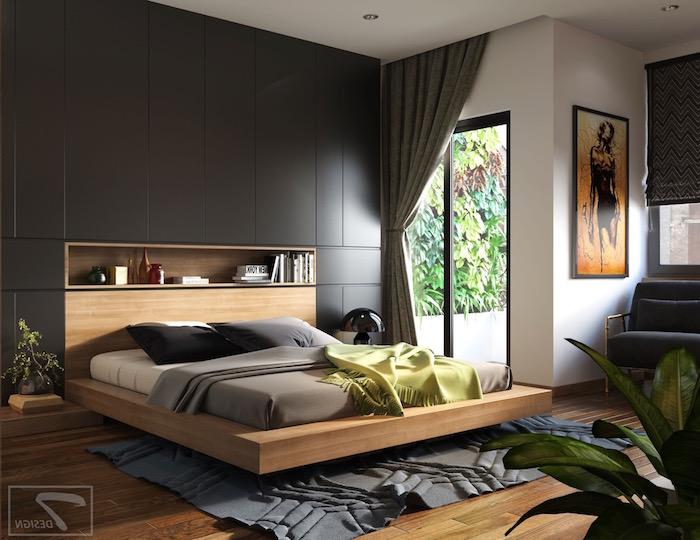 Holzbett mit Schrank integriert in der Wand, Wandfarbe Schwarz