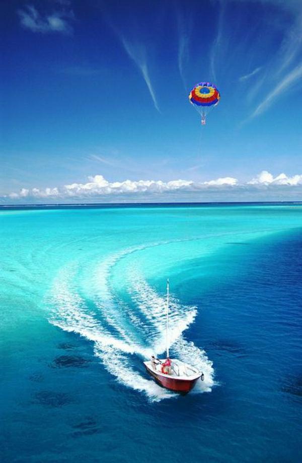 Fallschirm-Paragleiten-Meer-Boot-Himmel-Wasser-exotisch