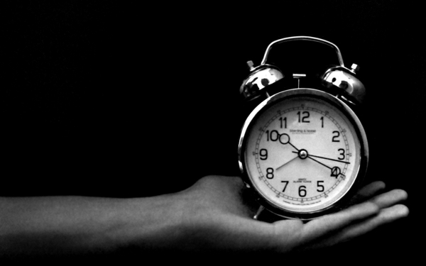 Wecker-Hand-Uhrzeit