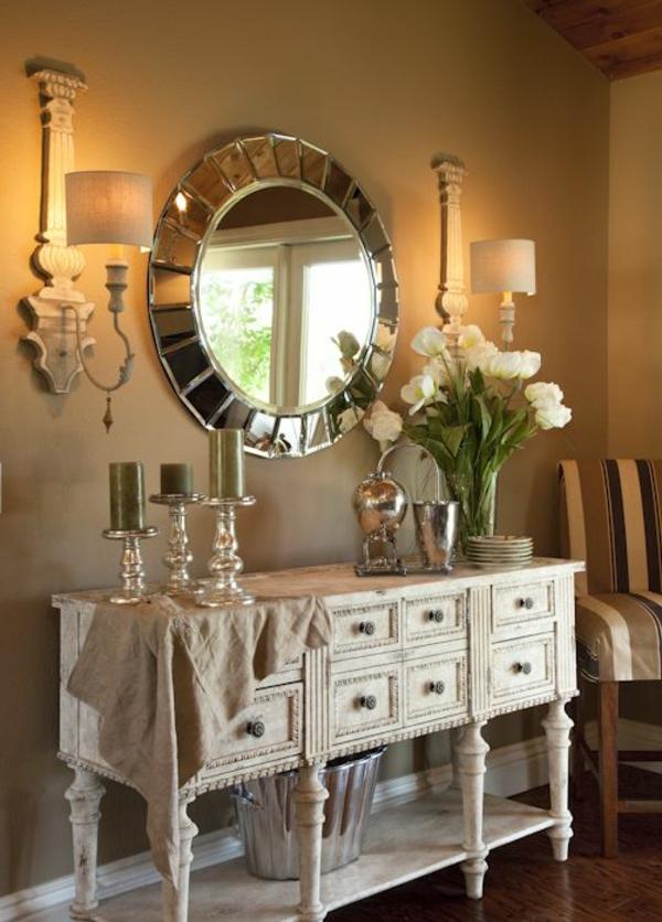 kommode-für-flur-blumen-auf-dem-schrank - spiegel mit runder form