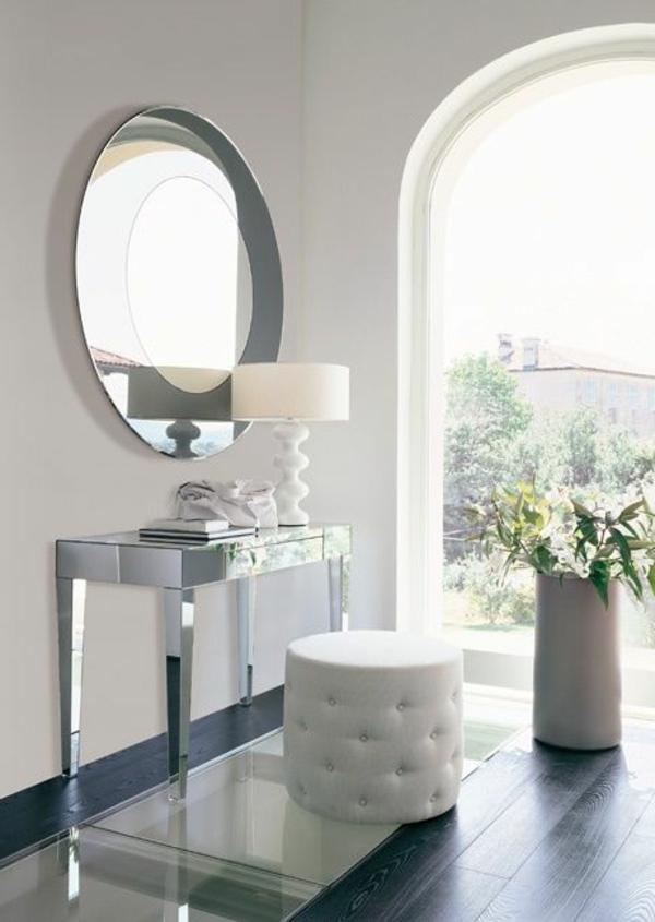 kommode-für-flur-rundes-design-vom-spiegel - weiße wände