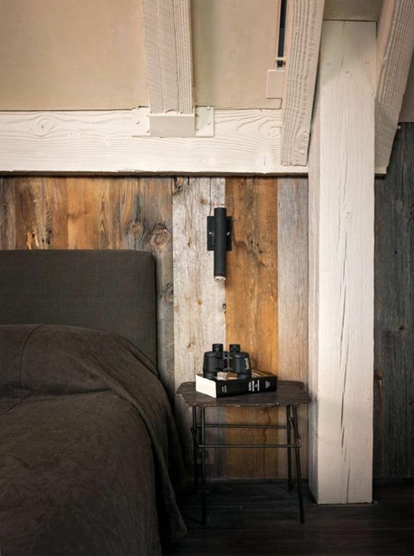 schlafzimmer-aus-massivholz-modernes-bett-mit-dunklen-bettwäschen