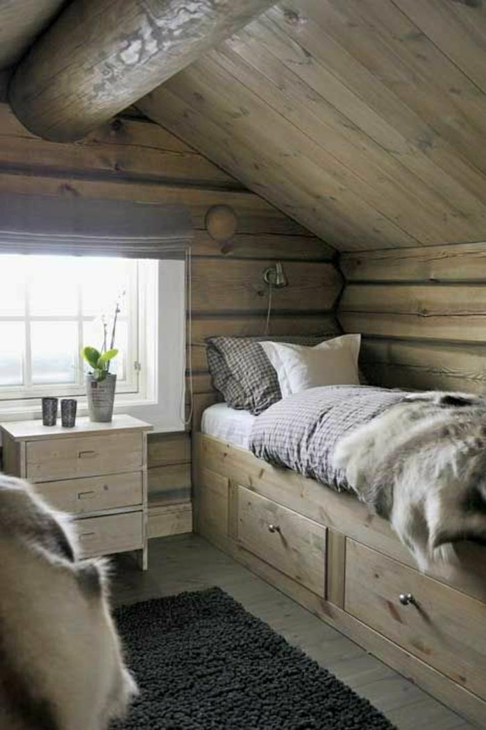 Berghütte-Holz-Dachschräge-Bett-Kissen-Pelz