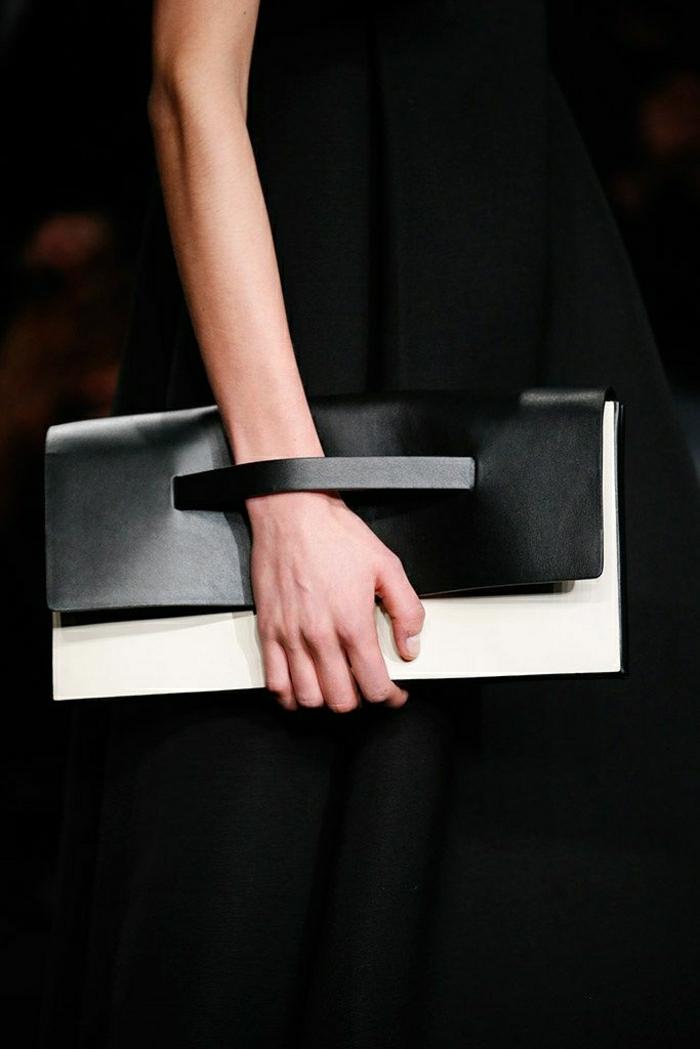 schwarze-Clutch-elegantes-Modell-weißer-Teil