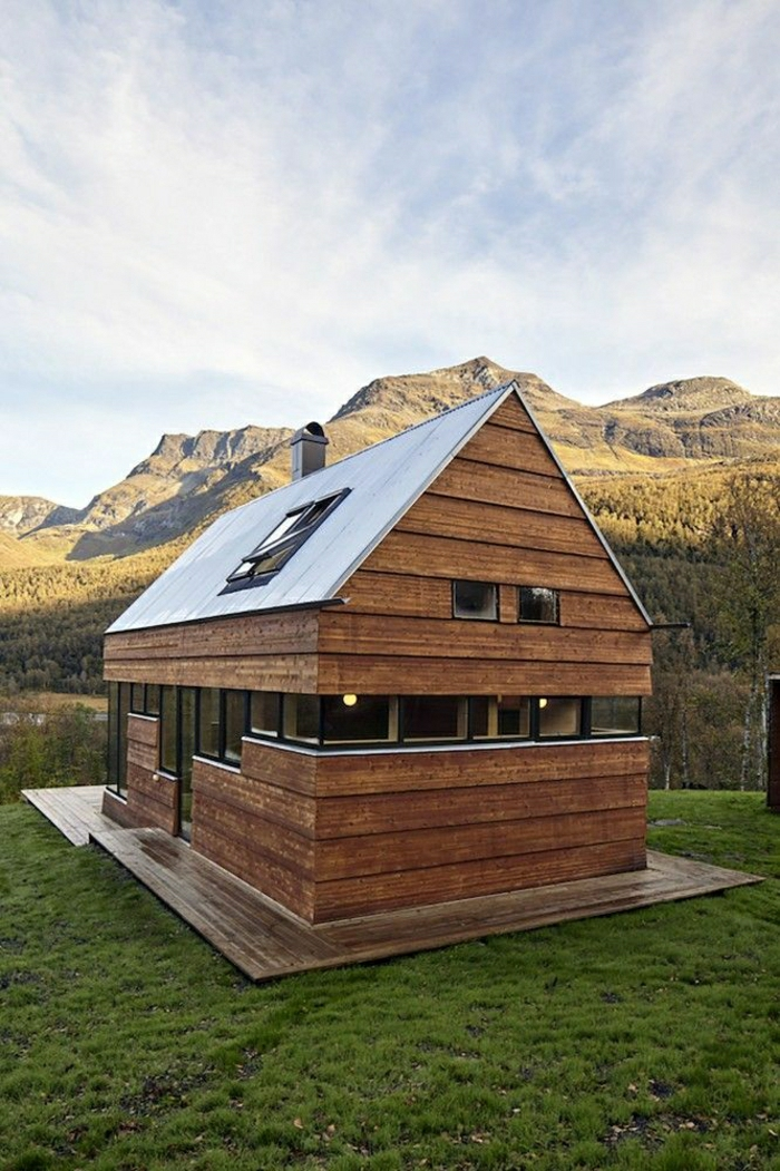 Hütte-Holz-Glas-modernes-Design-Gebirge-Gras-Natur