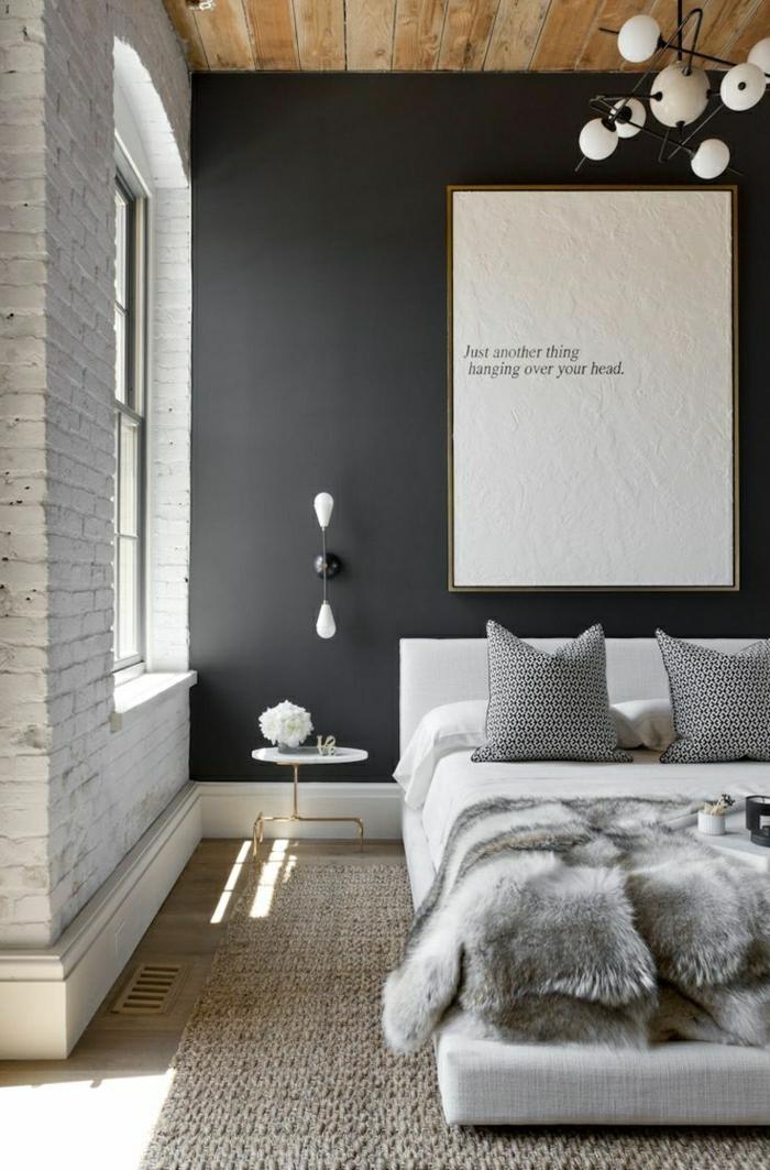 Schlafzimmer-Ziegelwände-schwarze-Wand-hölzerne-Zimmerdecke-Bild-Aufschrift