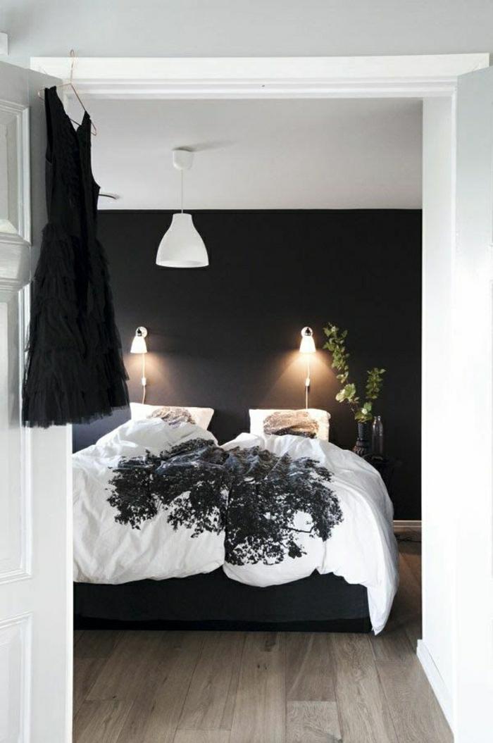 Schlafzimmer-norwegisches-Design-extravagant-schwarze-Wand-Kleid-weiße-Bettwäsche-schwarzer-Akzent