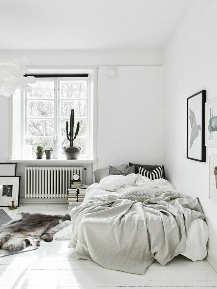 Sclafzimmer-scandinavisches-Design-Bett-Tierhaut-weiß