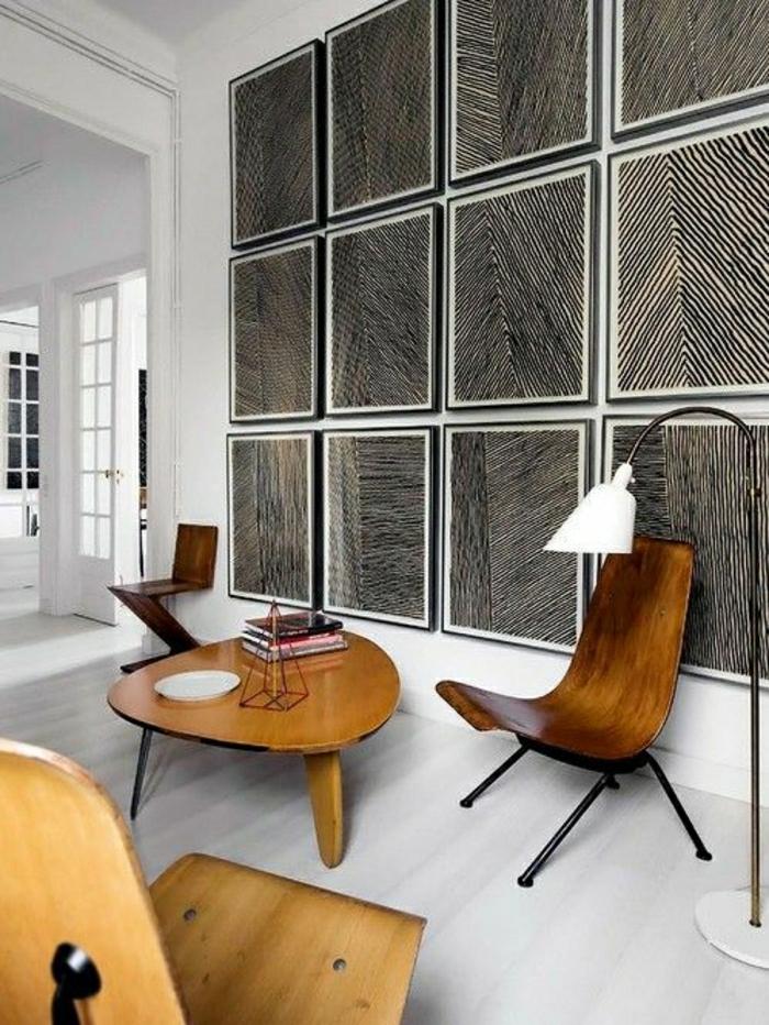 Wohnunh-skandinavisches-Design-weiße-Wände-hölzerne-Möbel-Bücher-graphische-Bilder