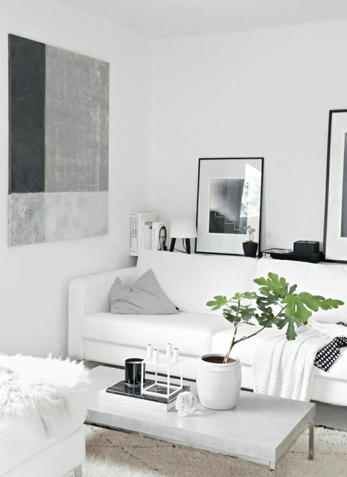 Wohnzimmer-weiß-grau-schwarz-skandinavisch-Sofa-Couchtisch-Pflanze-Bücher-Bilder