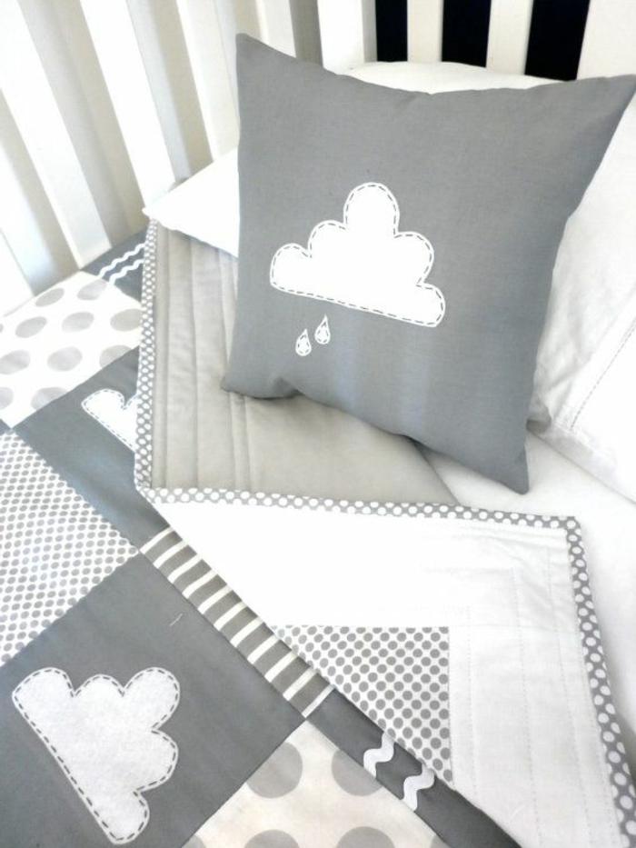babyzimmer-design-graue-süße-kissen