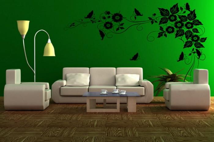 grünewandfarbedekorativeformenanderwandimwohnzimmer