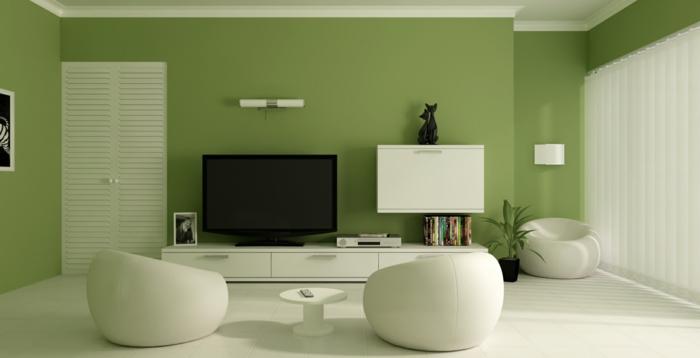 fernseher und grüne wandfarbe im modernen wohnzimmer