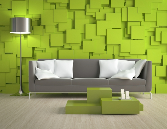 grünes wohnzimmer ideen:moderne grüne wandfarbe im wohnzimmer mit einem grauen sofa