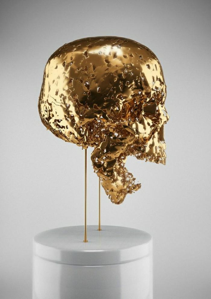 moderne-Skulptur-goldener-Schädel