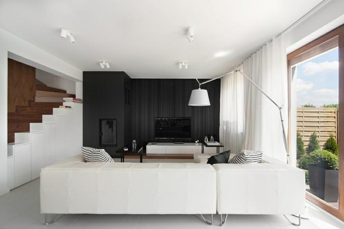 Weißes schönes wohnzimmer mit akzentwand in schwarz moderne