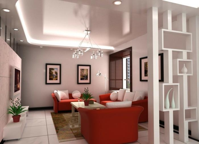 raumtrenner-aus-holz-rote-sessel-im-wohnzimmer