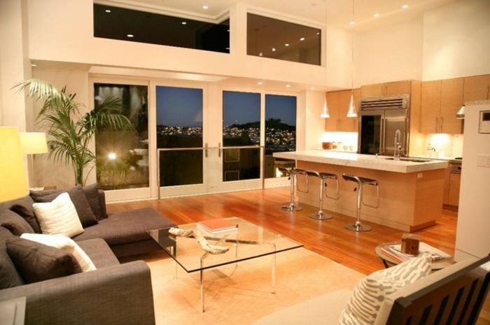 wohnzimmer-mit-küche-kochinsel-und-gläserne-wände
