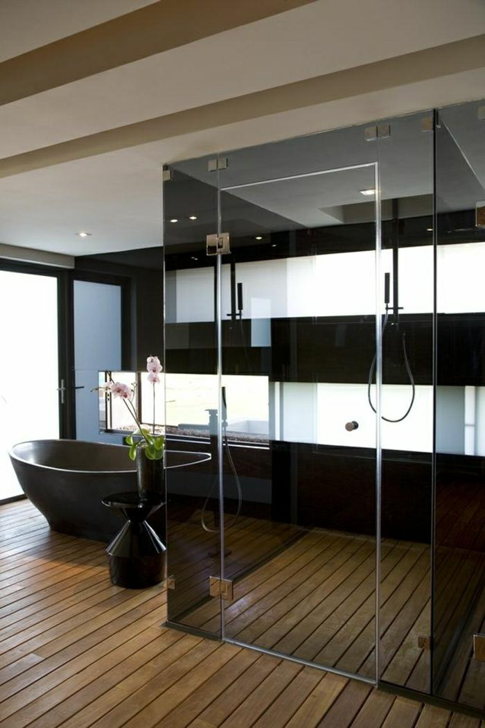 Duschabtrennung-Glas-Badewanne-schwarz-räumliches-Badezimmer-Orchideen