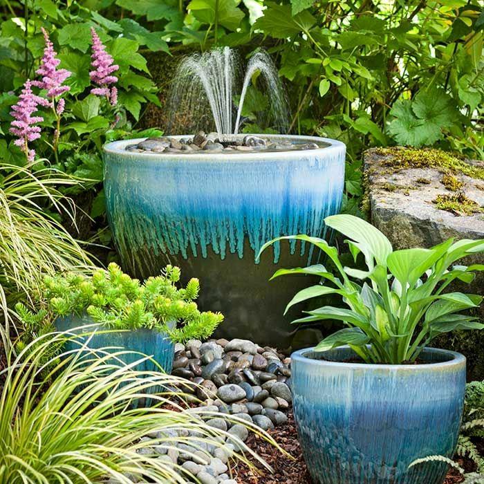 Garten-Hof-keramischer-Wasserbrunnen-dekorative-Steine-Blumentopf-Pflanzen