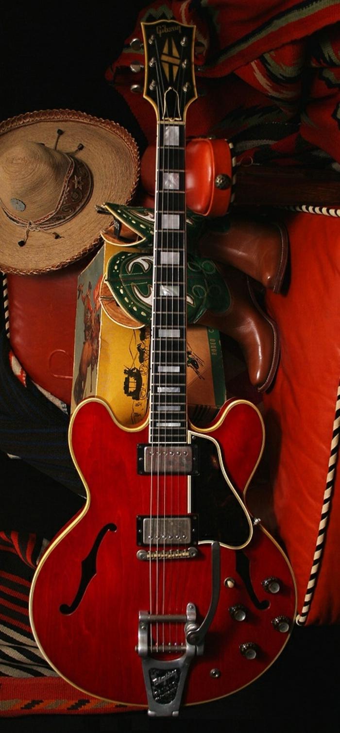 Gitarre-Gibson-Strohhut-Cowboy-Stiefel